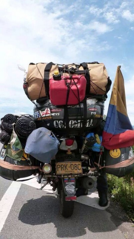 motorcyle loaded with excess luggage